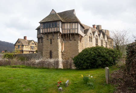 Gatehouse entrance to Stokesay castle on a dark cloudy day