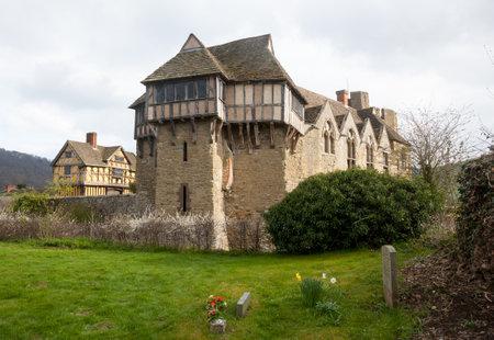 gatehouse: Gatehouse entrance to Stokesay castle on a dark cloudy day