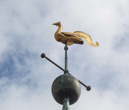 laurence: Golden swan weather vane on roof of tower of parish church of St Laurence in Ludlow