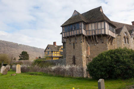 historical periods: Stokesay castle on a cloudy day from cemetery Editorial