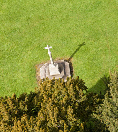 laurence: Carving of stone cross on lawn taken from roof of tower of parish church of St Laurence in Ludlow