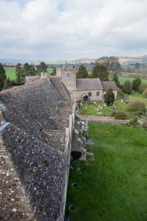 Roof of Stokesay castle leading to church and graveyard and cemetery photo