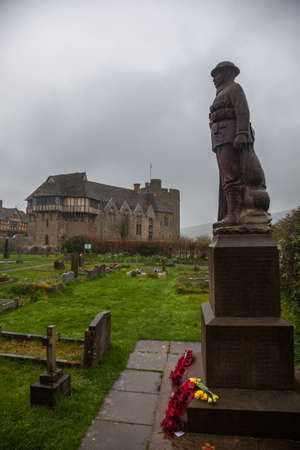 gatehouse: Stokesay Castle in England on damp raining day from cemetery