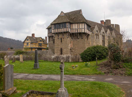 historical periods: Gatehouse entrance to Stokesay castle on a dark cloudy day