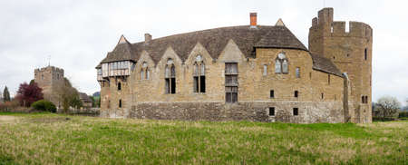 historical periods: Panoramic view of Stokesay castle with the parish church on cloudy day