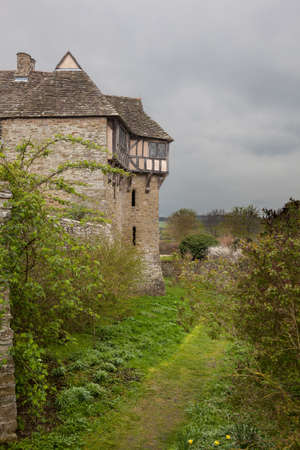 Moat around Stokesay castle on a dark cloudy day