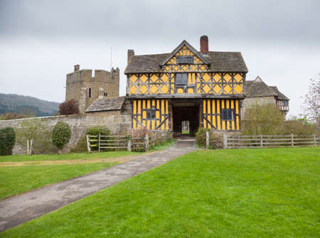 gatehouse: Gatehouse entrance to Stokesay castle on a dark cloudy day