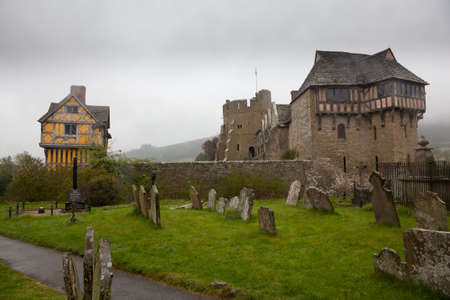 manor: Stokesay Castle in England on damp raining day from cemetery
