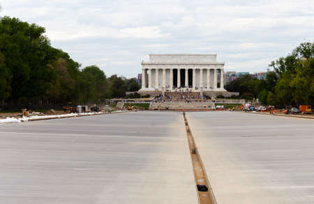 WASHINGTON DC - APRIL 17: Constructing new concrete floor of  reflecting pool in front of Lincoln Memorial in Washington DC. The project will cost $30.7M.