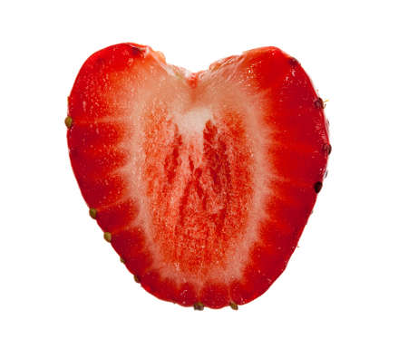 Freshly sliced strawberry in shape of heart isolated against white photo