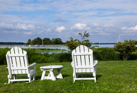 patio chairs: Empty patio chairs by side of the Chesapeake bay overlooking St Michaels harbor