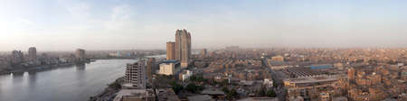 nile: CAIRO - MARCH 8: Panorama of Cairo and the Nile with Fairmont Nile City Hotel on March 8, 2010. The 34 storey towers were completed in 20012.