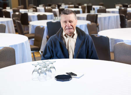 Senior male weeping in empty meeting room workplace harassment photo