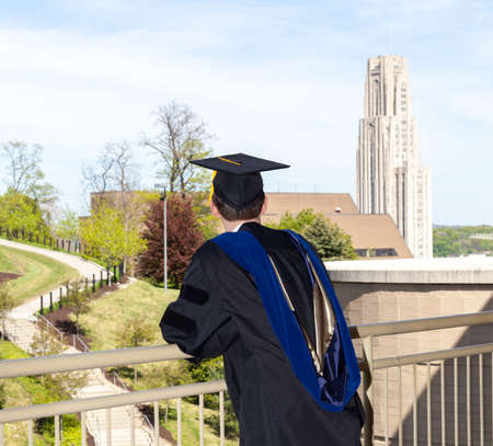 doctoral: Doctoral graduate looking toward Cathedral of Learning at University of Pittsburgh