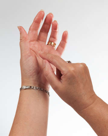 Concept showing an empty hand as if it was holding a phone and pressing keys on screen of smartphone Stock Photo - 14036800