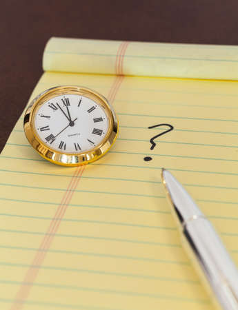 Concept for urgent decision making with clock on paper and question mark on pad Stock Photo - 14212153