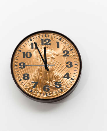 Concept of time is money from a wall clock close to midnight made from gold coin