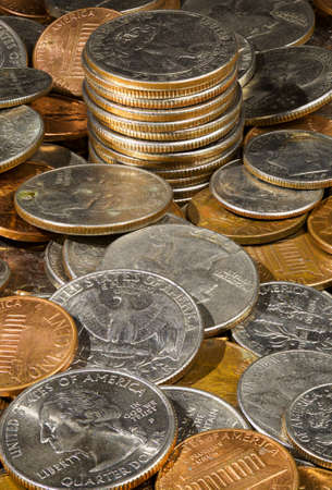 Macro image in deep focus of a pile of USA currency coins in stacks photo