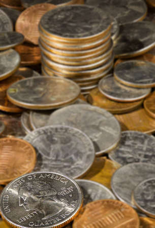 Macro image withy focus on quarter in a pile of USA currency coins in stacks photo