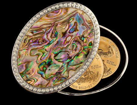mother of pearl: Isolated oval mother of pearl jewelry box with pure gold coins as savings