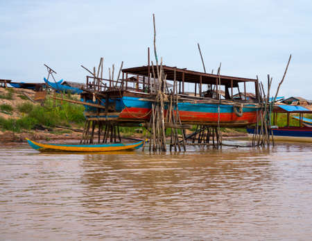 Floating village on Lake Tonle Sap in Cambodia with some houses made from boats photo