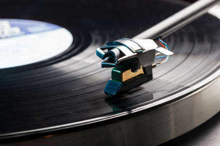 on records: Long Playing record LP on retro record player with tone arm and cartridge