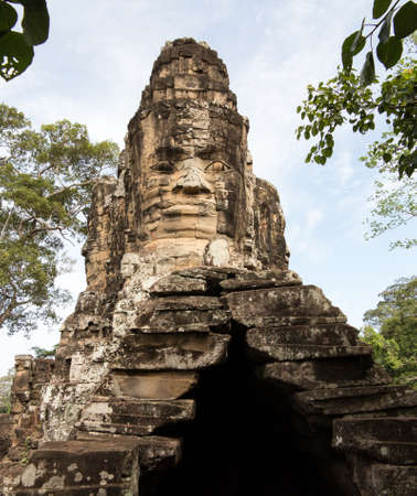 Carved stone south gate to Angkor Thom in Cambodia photo
