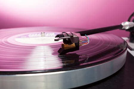 lp: Long Playing record LP on retro record player with tone arm and cartridge
