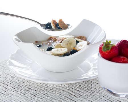 Breakfast of blueberries, bran flakes strawberries with banana photo