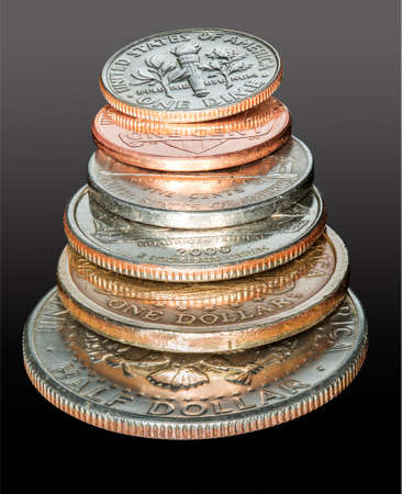Macro stack of all the US coins circulating in USA from dollar and half dollar coin to cent