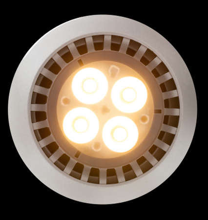 LED Light bulb illuminated and taken from above and isolated against black photo