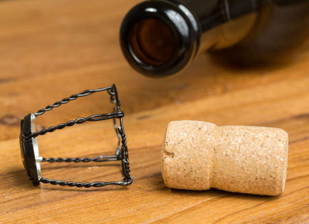 Champagne style cork and retaining cap by brown bottle of strong belgium ale beer photo