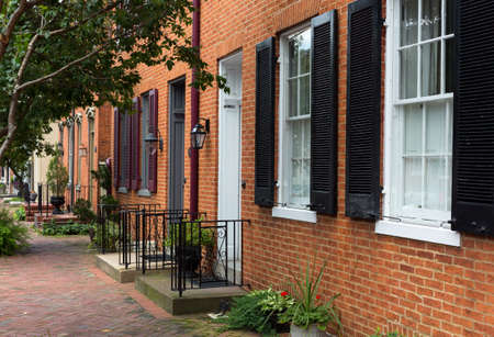 shutter: Red brick georgian houses in Frederick Maryland on historic street Stock Photo
