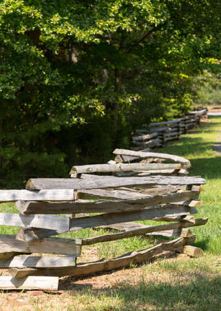 split rail: Traditional split rail fence by side of woods or forest