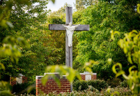 Statue of Christ being crucified on cross in stations of the cross in garden photo