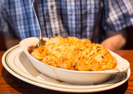 minced pie: Shepherds or cottage pie with baked mash potatoes in restaurant