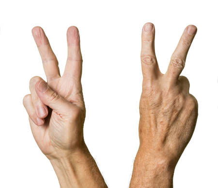 Pair of caucasian hands in V sign of senior middle aged male isolated against white Stock Photo - 14948881