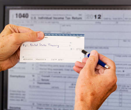 Electronic tax form 1040 for 2012 for US individual return on screen with check payable to US Treasury photo