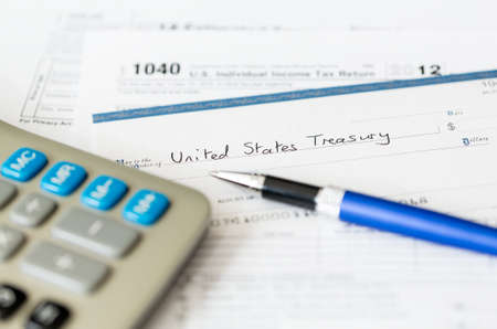 Pen And Checkbook On Top Of Tax Refund Check On A 1040 Tax Form ...