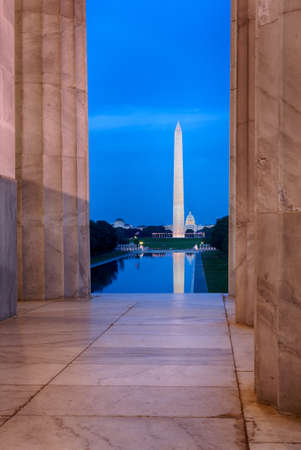 Washington Monument in DC and Capitol with reflections in new Reflecting Pool framed by columns of Jefferson memorial photo