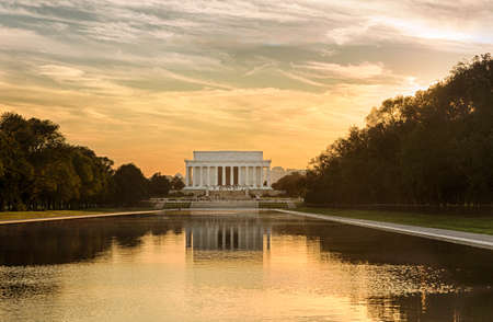 jefferson: Setting sun illuminates Jefferson Memorial in Washington DC with reflections in new Reflecting Pool