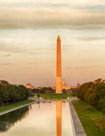 Setting sun illuminates Washington Monument in DC and Capitol with reflections in new Reflecting Pool Stock Photo - 14979443