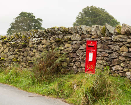 dry stone: Red King George GR post box in dry stone wall in Lake District