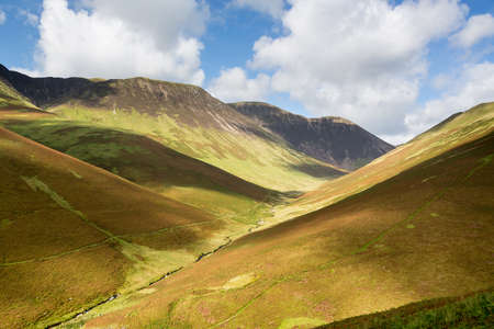 newlands: View over Newlands Valley from pass showing steep sided mountains and hills in English Lake District