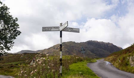 lake district: Old signpost near Wrynose Pass in English Lake District Stock Photo