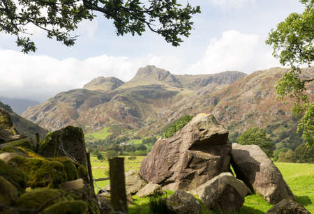 Sun illuminating Langdale Pikes in English Lake District Stock Photo - 15363416