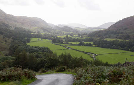 countryside landscape: Steep hairpin bends on Handknott pass in English Lake District