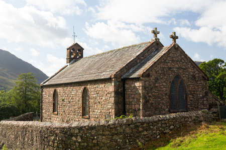 Stone church by side of road in Buttermere in English Lake District