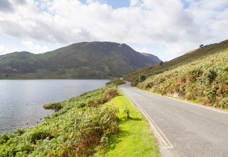 View of Crummock Water with road in English Lake District