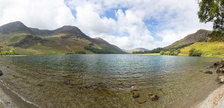 Buttermere lake in Lake District in England looking down length of the water Banco de Imagens